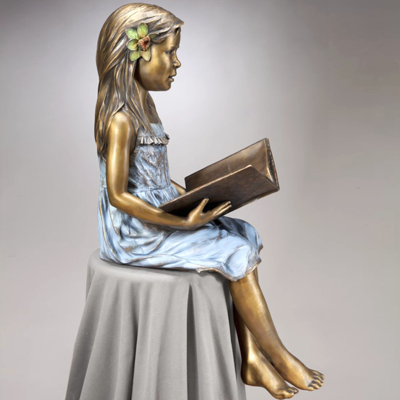 Lovely sitting bronze girl statue with reading